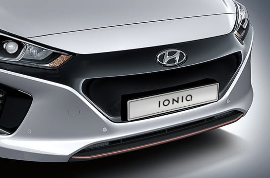 Closer view of side front part of white Ioniq Electric